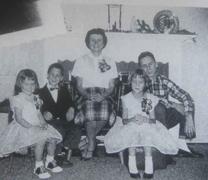 Ted Bundy poses with his mother Eleanor Louise Cowell, center and three half siblings.