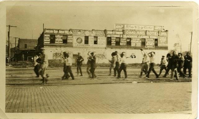 Group of black men being marched down the streets of Greenwood.